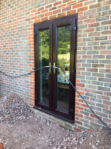 Cutting In French Doors Four Marks Hard Landscaping Sanders Builders Builder Alton Basingstoke Chawton Farnham Four Marks Ropley Winchester Hampshire Surrey